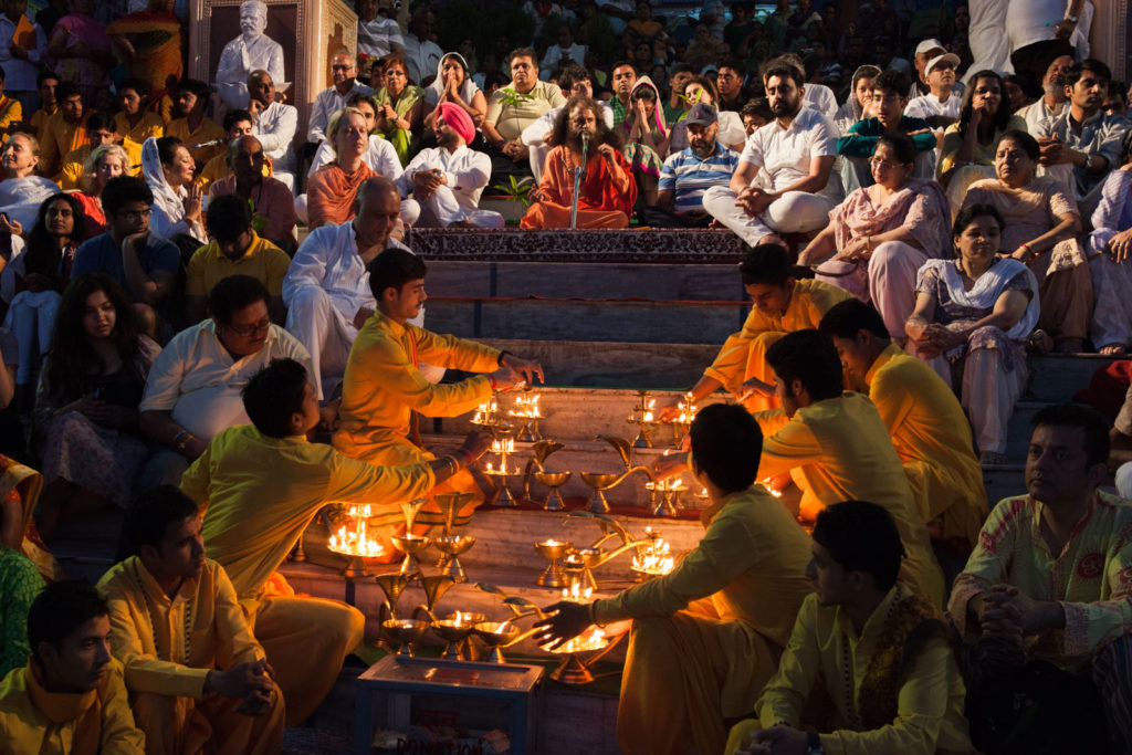Ganga Aarti ceremony at Parmarth Niketan an ashram located in Rishikesh, Uttarakhand, India. The sunset Ganga Aarti draws between hundreds of visitors each day. The Aarti is a pleasant ritual that uses fire as an offering of worshipping the Ganga.